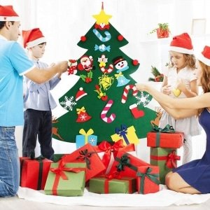 Foto família arvore de natal presente